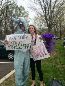 AN ELEPHANT OF A PROMPOSAL: Joe Meyer '16 asks Becca Archambault '16 to prom with an elephant costume, a poster, and a bouquet of flowers. Photo Courtesy of Nina Pagano '16