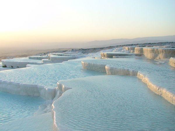 travertine terraces at pamukkale, near denizli, turkey.  it looks like a sheet cake