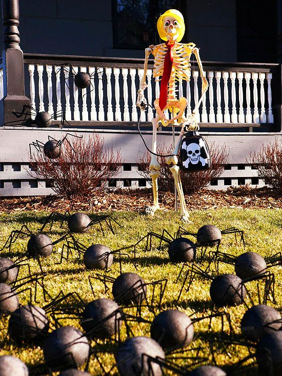 •Spider-Filled Front Yard Embrace the spirit of Halloween in your front yard with this spider-filled bonanza. Secure a skeleton to the ground with rebar; use monofilament to pose the arms. Create a swarm of spiders with inexpensive plastic foam balls and chenille stems; secure to the ground with wired florist's picks.