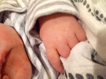 """After giving birth in February 2015, the country star took to all her social media pages to share an adorable first peek of her newborn. She shared, """"Tiny hands and tiny feet? God has blessed us with an amazing gift! Isaiah Michael Fisher -- born on February 27. Welcome to the world, sweet angel!"""""""