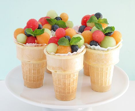Fruit Salad Ice Cream Cones - line cone with cupcake liner, fill with candy/rice at the bottom, top with fruit scooped out with a melon baller (for easy stacking use at least 2 different size melon ballers)