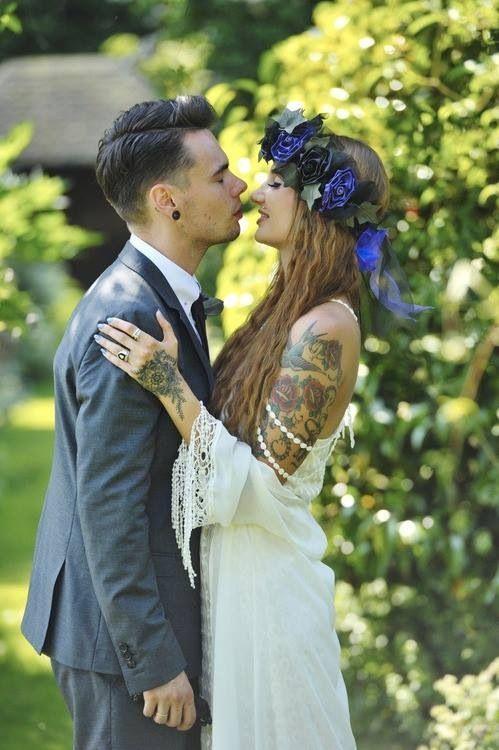 Tattooed couple at wedding. Love.