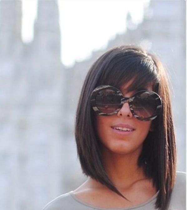 Brown hair shoulder length with bangs