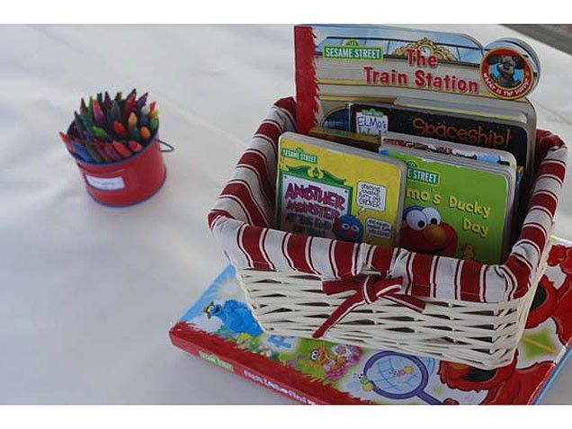 Elmo Extravaganza - Reading and drawing table. Wrap a table with paper and have crayons out as well as some Elmo books