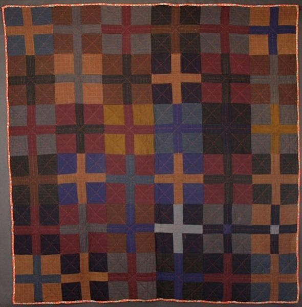 """Mennonite Wool Four Patch Quilt: Circa 1930: Pa. The maker of this Four Patch quilt has achieved a three dimensional effect in a very simple pattern. In part, this is due to the use of related, dark but not drab, materials. Many of them are subtly patterned as is visible in the close-up photos. The use of red quilting thread in a crisscross pattern that is at 45 degree angles to the squares also contributes. Measures 80"""" square."""