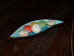 Macarons: (L-R) hazelnut, raspberry, vanilla (front), passionfruit (back), pistachio, champgane