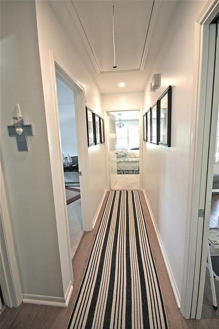 upstairs hall - rug, black and white dash and albert