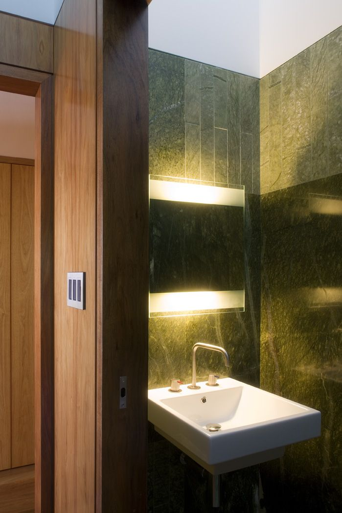 Samford House: Basin nook with wall mounted mirror cabinet. See more at http://blighgraham.com.au/projects/samford-house-1