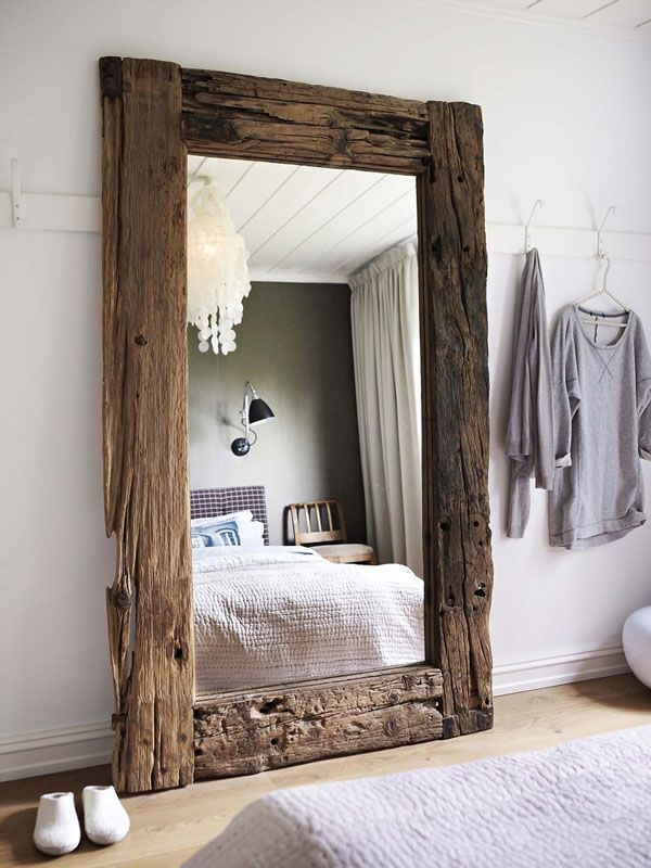 Make your bedroom feel larger with an oversized mirror