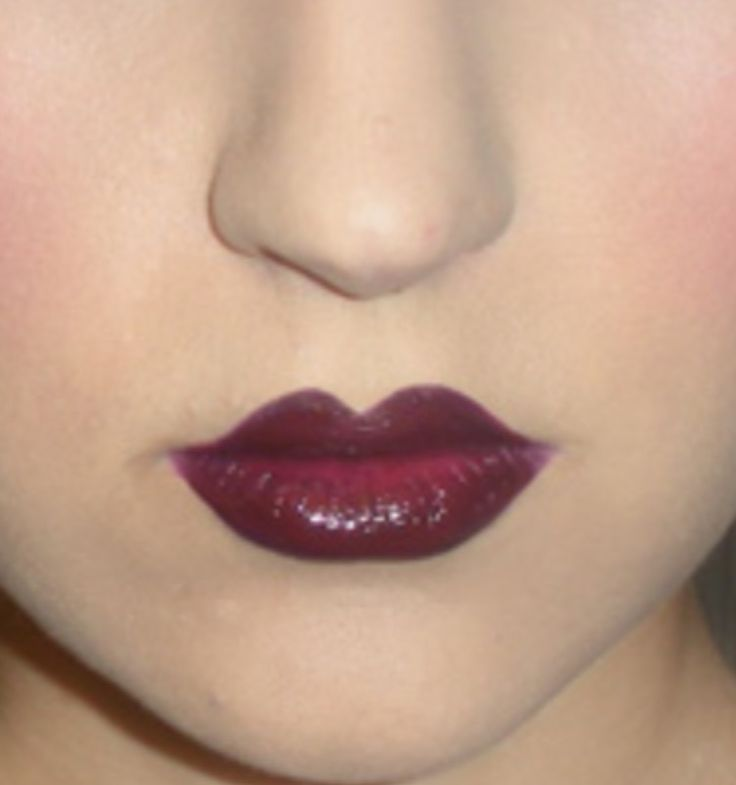 1920s lips - the lips were coloured in a deep plum or reddish brown. The width of the lip was usually shortened and a classic cupid bow lips drawn in