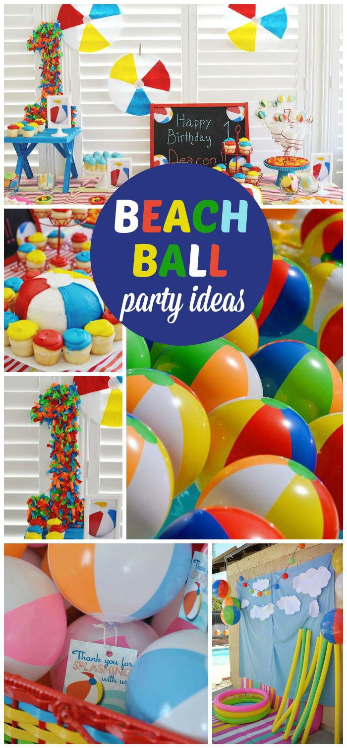 A colorful beach ball first boy birthday party with fun decorations and treats! See more party planning ideas at CatchMyParty.com!