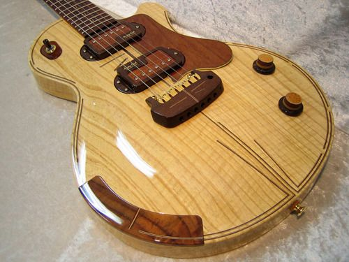 Jersey Girl Homemade Guitars... interesting bridge piece