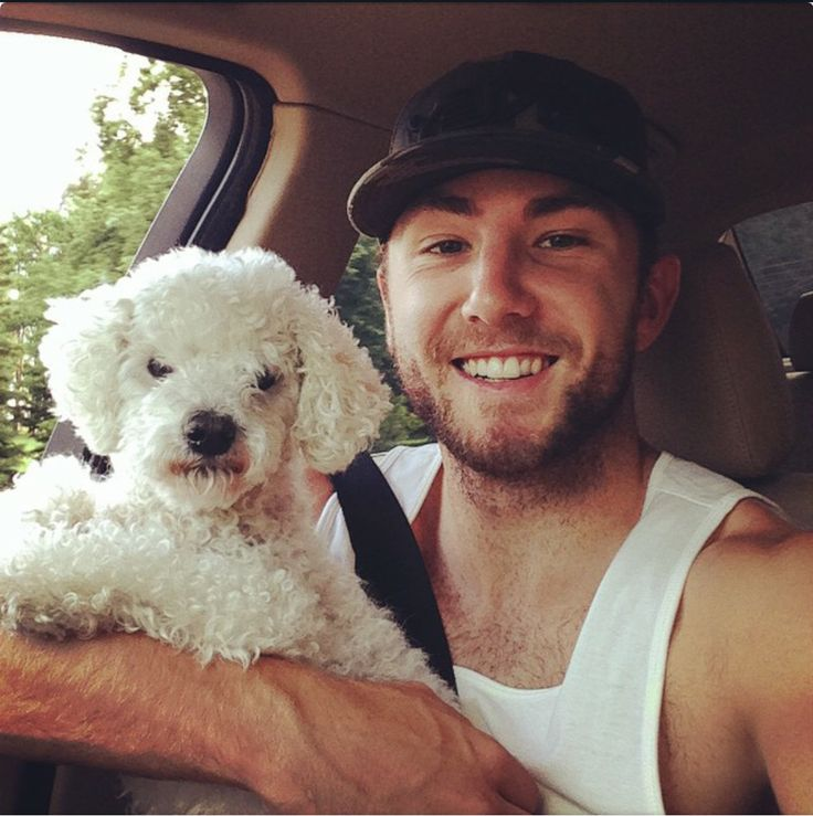 San Jose Sharks: Barclay Goodrow holding a dog