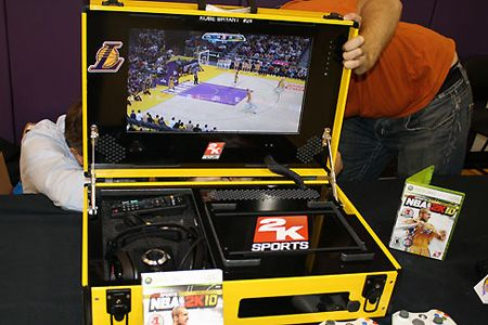 THIS IS SO AWESOME AND WHEN YOU ARE A GREAT PLAYER AND A NBA SUPERSTAR GREAT THINGS LIKE THIS ARE MADE JUST FOR YOU AND THIS IS A GAMING CONSOLE MADE JUST FOR KOBE BRYANT WITH ALL KIND OF CUSTOM LAKERS THINGS THAT IS JUST VERY AWESOME AND IT IS A PORTABLE XBOX SYSTEM THAT KOBE CAN TAKE ON THE ROAD WITH HIM OR ADD IT TO HIS COLLECTIBLES ONE DAY TO SHOW PEOPLE HOW GREAT OF A SYSTEM THIS IS AND HOW LUCKY HE IS THAT THEY MADE SOMETHING LIKE THIS JUST FOR HIM
