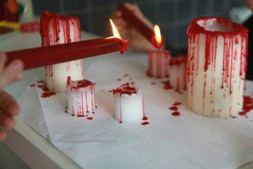 Bloody candles for halloween! Cost $3 for 2 bloody candles. I bought one red and two white candles at the dollar store and melted the red onto the white. mine looked alittle more light red or pinkish than i would have liked so i would recommend getting a very dark red to melt