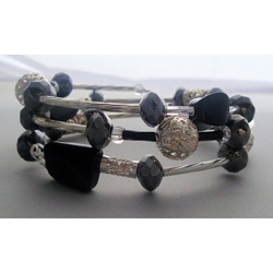 @Overstock - This beautiful handmade wrap bracelet is sure to gain compliments from many admirers. This bracelet was made with gorgeous twisted black glass beads, various filigree silver metal beads, & one of a kind liquid twist tube beads.http://www.overstock.com/Main-Street-Revolution/Heavenly-Beads-Filigree-Silver-Twisted-Black-Wrap-Bracelet/6804175/product.html?CID=214117 $23.99
