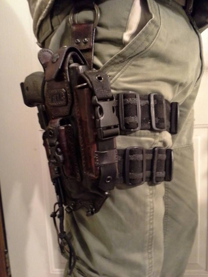 Tactical Leather. I think men need one of these... What for, I have no clue but it looks cool. I would buy it, if he promises to wear it around the house at least once... if you know what I mean...