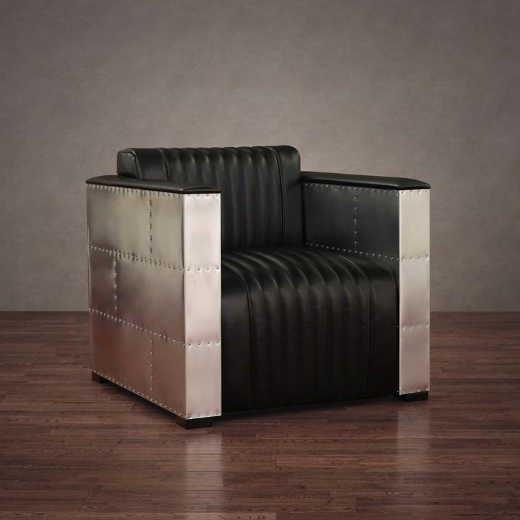 This chair features luxuriously white leather upholstery with a modern yet natural embossing combined with aluminum sheeting held together by over 450 individual screws. The modern style of this chair brings comfort and style to any setting.