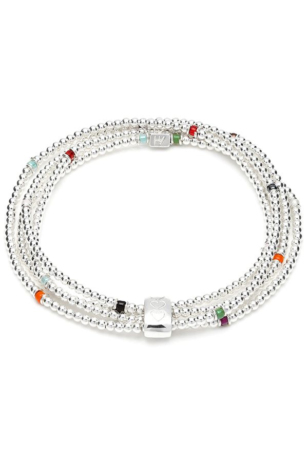 This outstanding bracelet comprises of a continues unbroken style that is wrapped around 4 times to create the ultimate layered look, held together by a 925 sterling silver oval featuring the 3 signature ANNIE HAAK hearts. This bracelet is beautifully designed using Japanese glass beads in a variety of complementing colours.