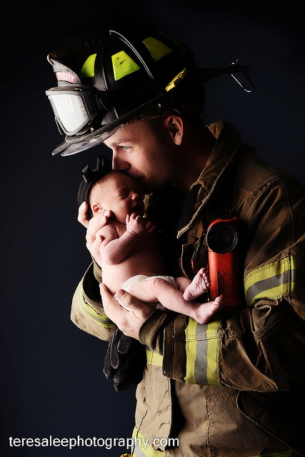 Fireman with baby. How beautiful and sweet :)