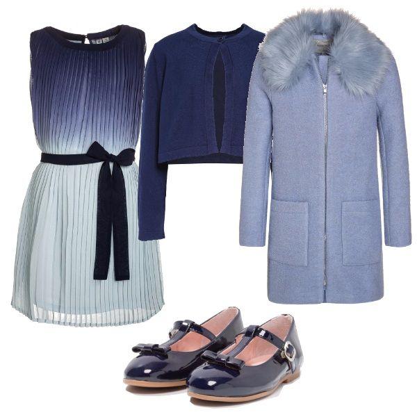 Per questo outfit: vestitino plissettato sfumato sui toni dell'azzurro e del blu con cinturina a vita, coprispalle blu, paperine in vernice blu con fiocchetto e cappottino azzurro con colletto in pelliccia.