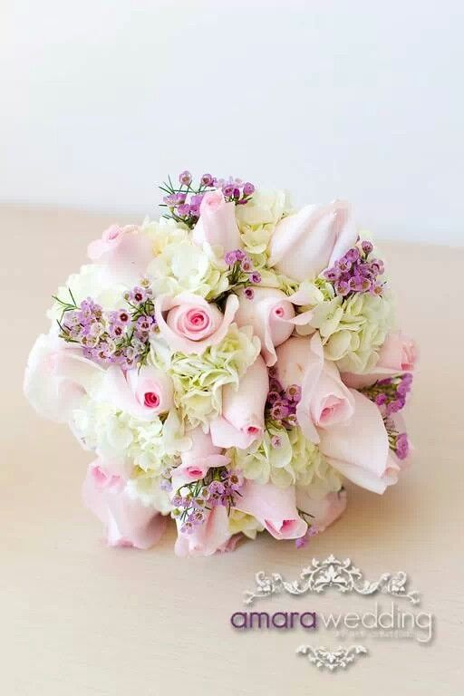 Bridal bouquet with hydrangeas, pink roses and wax flower by Amara Wedding