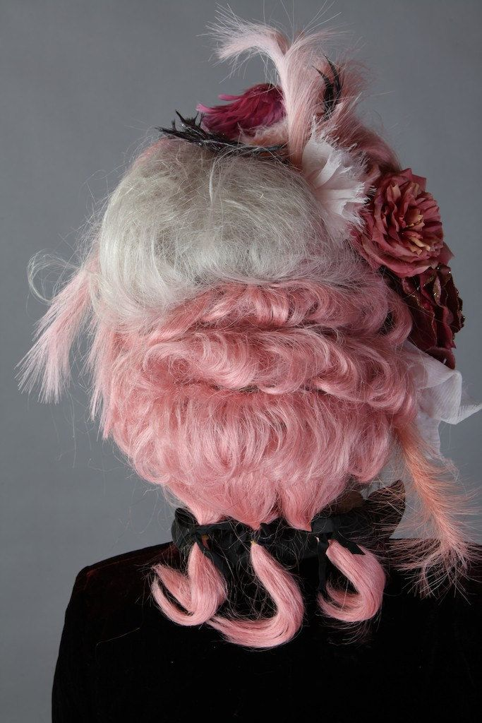 Back detail of Pink Rococo style wig with all the trimmings - flowers, ribbons, feathers and not one but three queues (pigtails)!