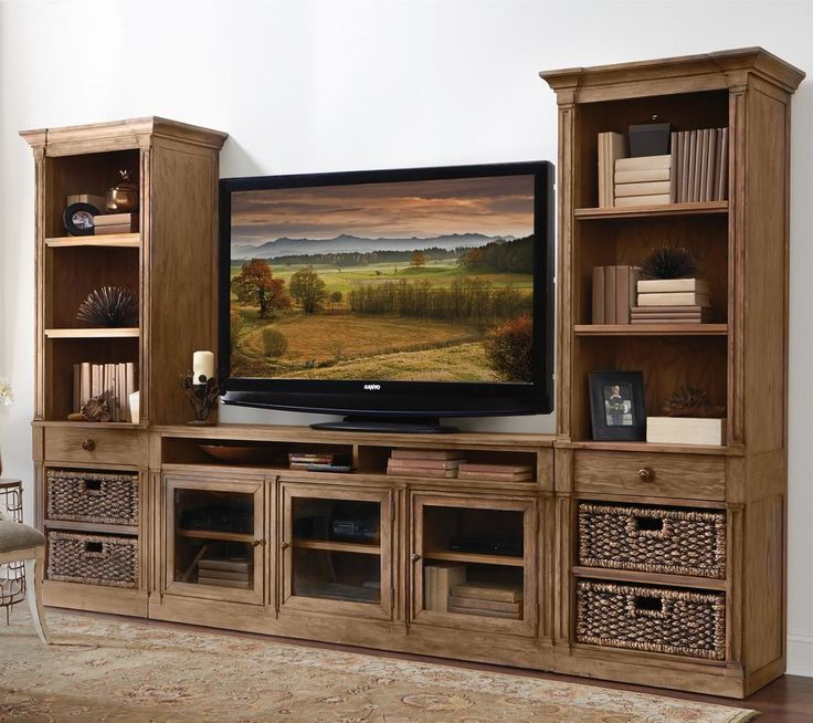 A toasted pecan finish adds warmth to the ash veneer exterior of this media center, nicely complementing the rich color of the included woven storage baskets. Accented with detailed molding and carved pilasters, the handsome design also incorporates plenty of storage; both open and enclosed, to keep your home theater setup neat and orderly.