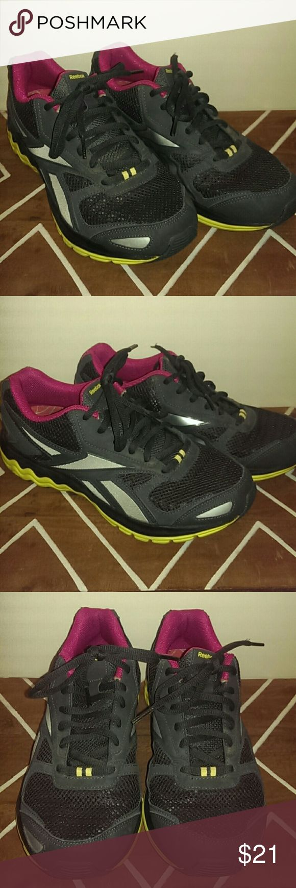 Reebok Running Shoes Reebok running/gym shoes. Lightweight and very comfortable. Factory insoles have been replaced with Dr. Scholl's Active Series insoles. Uppers are pretty clean as they were largely worn for treadmill running. Black with accents of silver, yellow, and pink. Offers welcome! Reebok Shoes Athletic Shoes