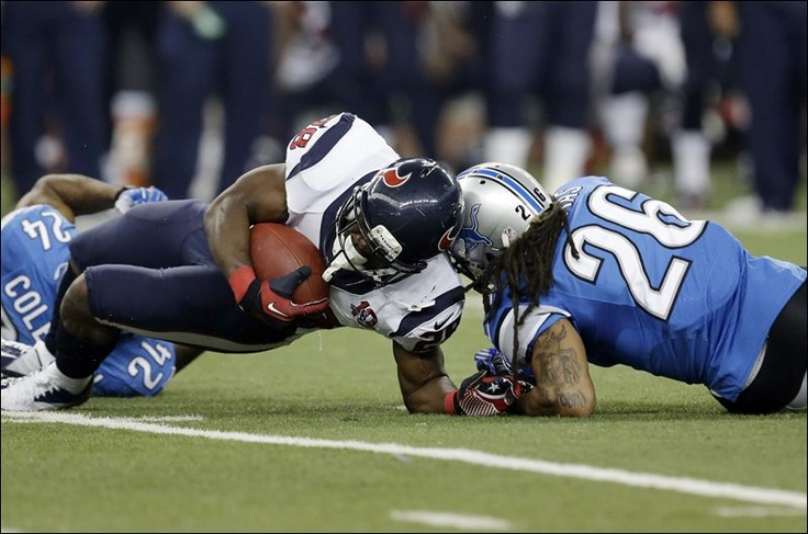 10-1!!!!!!Houston Texans running back Justin Forsett is hit by Detroit Lions free safety Louis Delmas (26) during the third quarter today at Ford Field in Detroit. Forsett scored an 81-yard touchdown on the controversial paly. ASSOCIATED PRESS