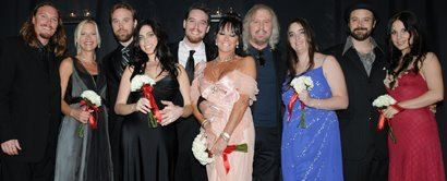 barry gibb photo: International Chairmen Linda and Barry Gibb (center) with their children,.Young Society Honorees (lr) Ashley and Therese, Travis and Stacey,.Michael, Ali, and Stephen and Gloria Gibb. 253411_1404588810489_2011274_n.jpg