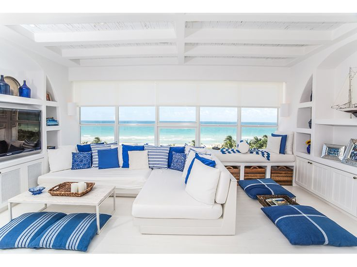 Modern Lantern is loving this Miami Beach Studio, designed by MRA Design. The lapis accents definitely give that pop of color, and tie in with the scenic background!