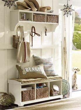 Pretty sunlight white bench with shelf with hooks above it