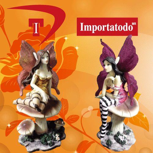 Figura decorativa Hada sentada sobre un hongo elaborada en Poliresina marca TRENTINO. Modelo 45-624