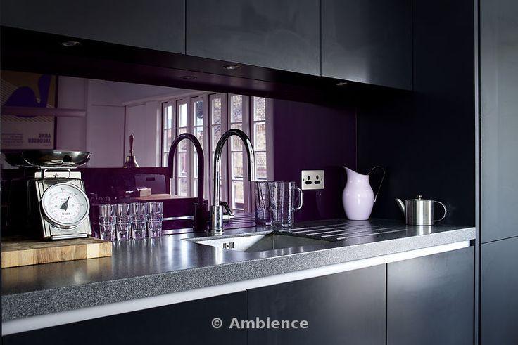 Kitchen detail, purple glass splashback behind the sink.