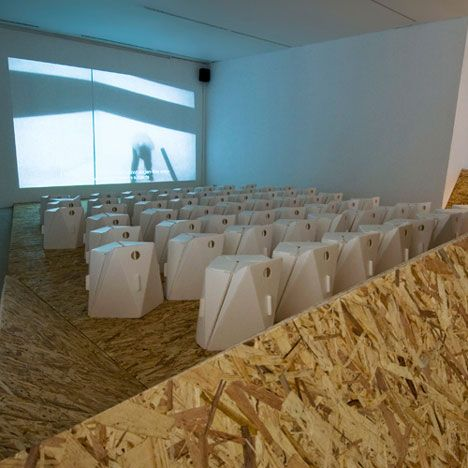 Temporary cinema at the Royal College of Art in London created from faceted planes of oriented strand board.