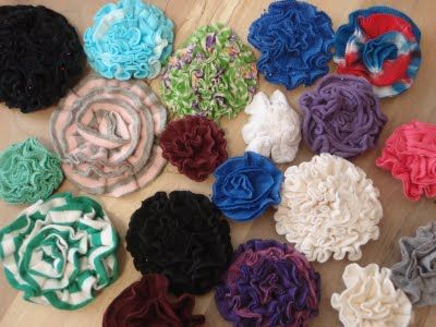 What to do with the hems left when you cut up your T's for flowers and scarves?  Make these flowers with them!