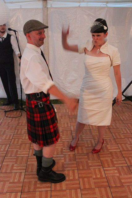 Kilted grooms rockin' them tartans AND he's wearing BOOTS with his KILT