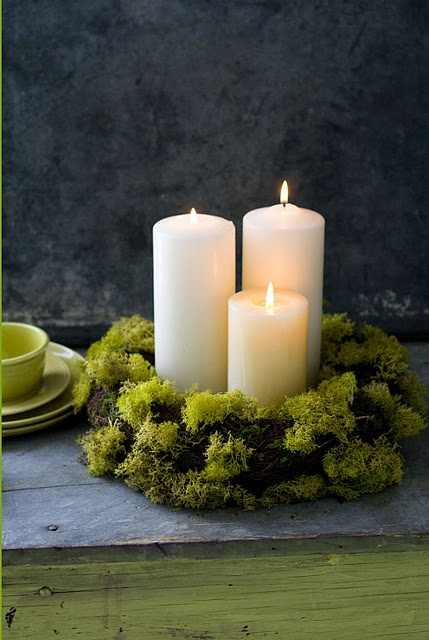 moss + candles - they'd have to be flameless candles for the venue, though