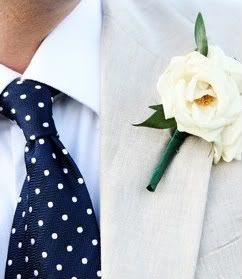 Navy blue polka-dot tie and simple white boutonniere