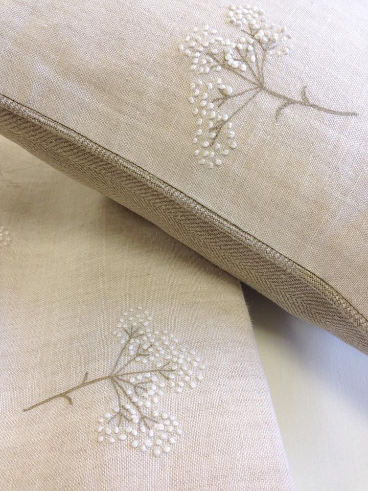 """Piped cushion in Peony and Sage's embroidered Cow Parsley on stone linen, backed with Herringbone """"Cashmere"""" linen. By Clarabelle Interiors."""