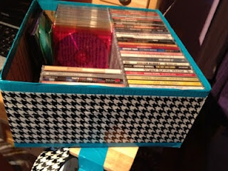 Duct tape + cardboard boxes = cheap storage bins