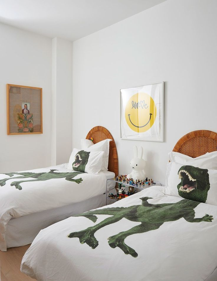 Punchy duvet covers adorn the twin beds in the kids room with a curtis
