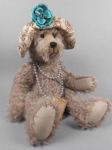 """Adopt a Bear todayGladys by: Linda Hood 17"""" fully jointed matted mohair bear, poly stuffed. Fabric hat with vintage flower pin. Original paper tag."""