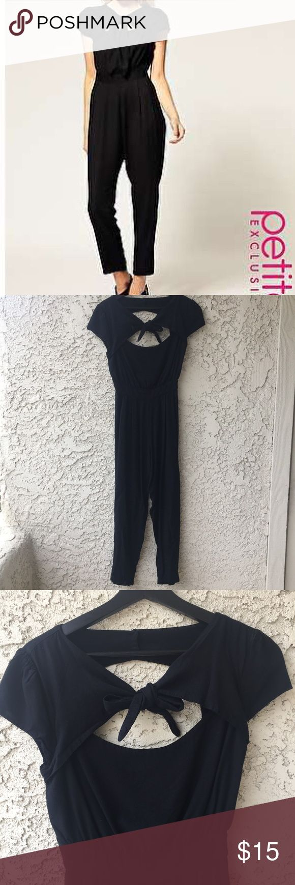 Asos Petite Jumpsuit with Cutout Back Amazing black jumpsuit with cut out back and tie in the front. It reminded me of an outfit from the 1940s. Very soft. The zipper is fully functioning but sticks a little, has been that way since I got it. ASOS Pants Jumpsuits & Rompers