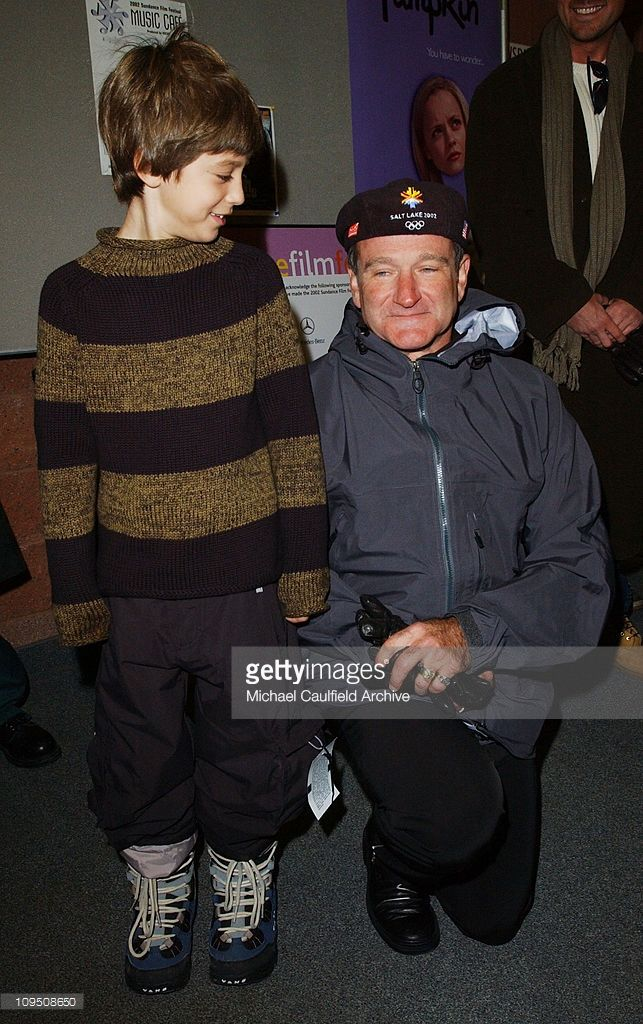 Robin Williams & Dylan Smith pose for photographers at the premiere of 'One Hour Photo' at the 2002 Sundance Film Festival.