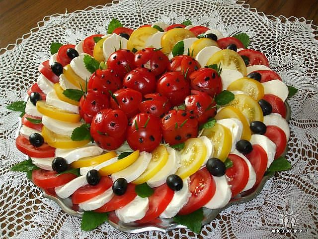 Caprese salad tray idea with red and yellow tomatoes