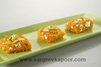 Gajar Halwa Burfi-Delicious fudge made from carrots and served with dry fruits and silver warq on it.