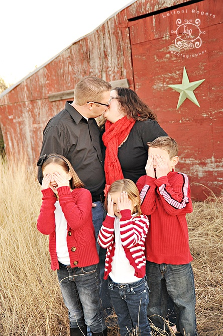 The kids in front of an old barn for Christmas card.