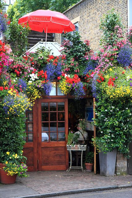 """Churchill Arms-    Kensington Church Street, London: See how you can transform an area from something ordinary into something """"Extra""""ordinary! Just takes a little """"Extra"""" in the gardening and flower department! Great example here and GREAT curb appeal! Another great example too of what we call a """"Parade Of Gardens""""!"""